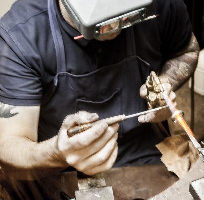 Jeweller Guy Wakeling in his showroom and workshop