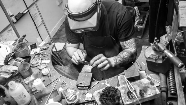 Gy Wakleing in his jewellery studio