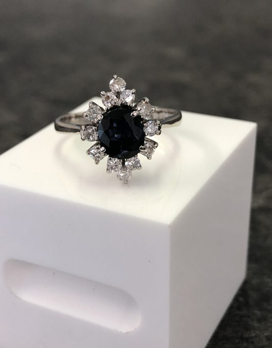 18ct White Gold Sapphire Ring surrounded by 12 Brilliant Cut Diamond