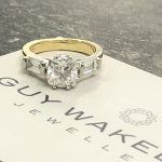 cushion cut and baguette diamond ring made from yellow gold